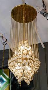 nice suspension made of a circular plate from where hangs tens of thin chains attached to