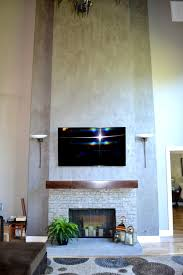 metallic plaster by modern masters creates a contemporary concrete look for a fireplace project by