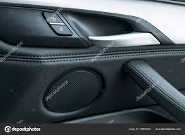 car door handle inside the luxury modern car with black leather and switch on control modern car interior details photo by bigtuna
