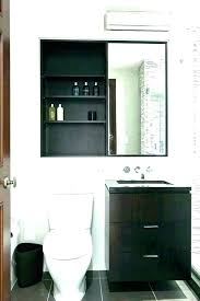black bathroom shelves over toilet floating cabinet to go above bath shelf height the roll toile