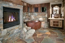 rustic stone bathroom designs. copper bathtub and flagstone slate create a fabulous, rustic bathroom [ design: high camp stone designs e