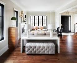 Black And White Living Room With Wood Floors And Gray