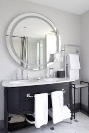 black vanity with speckled white top backlit mirror mirror tv lighted mirror mirror