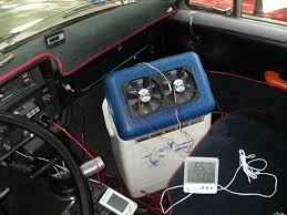 air conditioning unit for car. we took the unit out to truck for a test run when it was well over 90 degrees fahrenheit (mid high 30s celsius people). air conditioning car