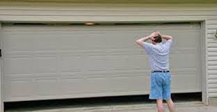 garage door dent repairAuthorised service agent for Gliderol and Centurion garage doors