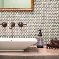 Penny Round Tile Accent Wall in Powder Room