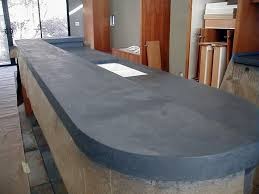 a closer view of a kitchen island with a concrete countertop