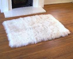 simple living room with small white faux fur area rug and white white fur rug home
