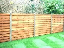 installing wooden fence on concrete