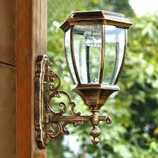 cool white 14 h dusk to dawn solar powered led outdoor wall light with
