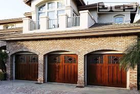 arched window garage wooden garage glass window brick wall three car garage dynamic garage door