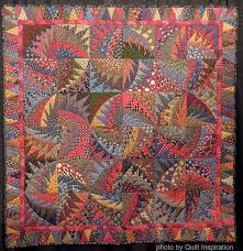 Quilt Inspiration: Necktie quilts for Dad & This stunning quilt was made entirely from recycled silk ties and silk tie  remnants from the Robert Talbott Tie Company. Virginia Anderson says: