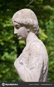 Woman Sculpture Light Old Stone Statue Of A Woman In Sunshine Stock Photo