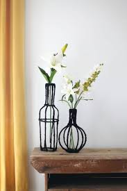 Turn some wire and scrap fabric into beautiful decorative vases for your  home! Click through