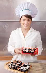 Sushi Cook Cook Woman With Cooked Sushi Rolls In Kitchen