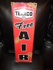 gas station with air pump. antique style-vintage look texaco free air dealer service station gas pump sign with
