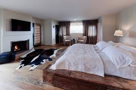 bedroom cowhide rug in rustic bedroom decorating ideas with