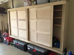 picture of finished garage storage cabinet with sliding doors