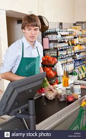 A Cashier Working In A Supermarket Stock Photo 33924216 Alamy