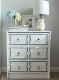 painting designs on furniture. Adding Brass Pulls And Painting Storage Furniture Item In Pastel Blue Color Designs On