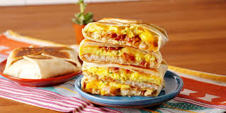 taco bell breakfast crunchwrap. Wonderful Bell Best Breakfast Crunchwrap Supreme  How To Make In Taco Bell Delishcom
