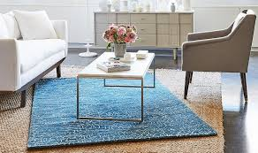 6 easy ways to master the layered rug look proper living room placement make elegant decoration
