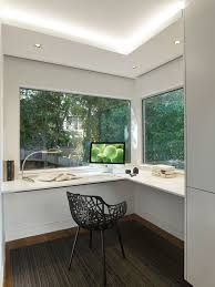 modern home office. Example Of A Mid-sized Minimalist Built-in Desk Carpeted Study Room Design In Modern Home Office E