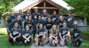 student organizations student life school of public and  a spea student organization poses as a group in front of a cabin