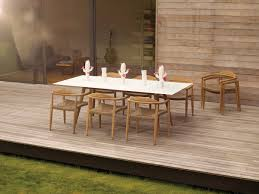Furniture Charming Rattan Dining Chairs And White Dining Table By