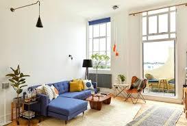 blue sofa living room living beige rug orange plastic chair blue sofa wooden coffee table royal blue sofa