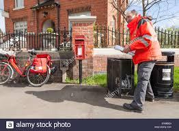outside the box office. Royal Mail Postman Collecting From A Box Outside The Old Post Office, Plumtree, Nottinghamshire, England, UK Office