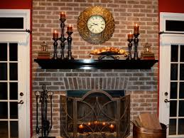 a creative living room with natural brown stone bricked wall fireplace iron fenced floating shelf beautified candle holder round wall clock a warm and cozy