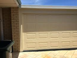 how to paint a garage door with a roller insulated roller garage door our can you