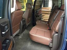the back seat offers plenty of room for s and the seat bottoms fold up