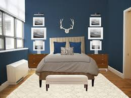bedroom dark blue wall theme and some white picture frames on it connected by grey