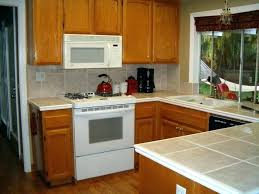 light brown cabinets brown painted cabinets brown painted kitchen cabinets with white appliances light brown cabinets