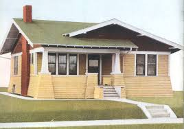 exterior paint application. fabulus bungalow with yellow and green paint colors for house exterior application, dark brown chimmey colour white on the outdoor garden stairs application r