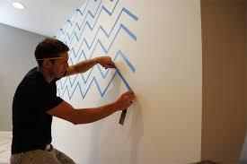 the result is a beautifully imperfect stencil that provides a hand painted feature wall for added impact in your home