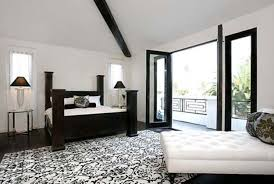 round mirror on the cream wall inside elegant bedroom with easy bedroom area rug