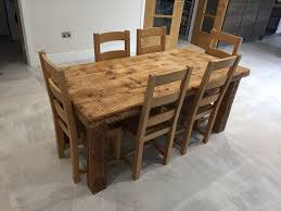 solid oak farmhouse dining table and 6 chairs