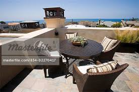 rooftop deck furniture. Contemporary Deck Table Chairs Rooftop Deck With Ocean View  Stock Photo Throughout Rooftop Deck Furniture N