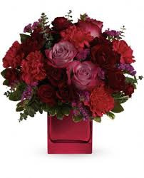 includes red and lavender roses hot pink carnations and orted fresh greens