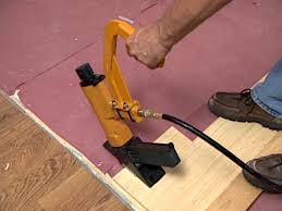use pneumatic flooring stapler to secure boards