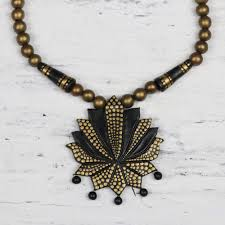hand painted black and gold lotus flower pendant necklace flowering lotus