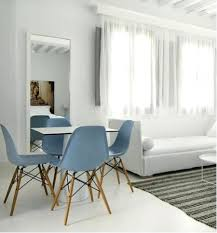 baby blue dining chairs above a room at the hotel in similar molded plastic side chairs