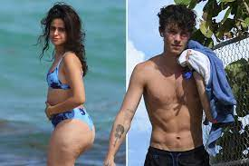 Wet Camila Cabello shows off curves on ...