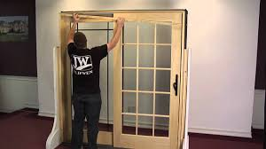how to remove and reinstall an operating panel in a sliding wood patio door