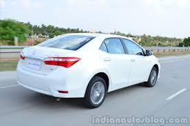 2014 Toyota Corolla Altis Petrol Review rear quarter moving ...