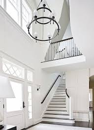 paul moon design susan marinello interiors amazing two story foyer with dorset two tier chandelier with torch arm