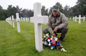 paul clifford 70 from boston ma usa places flowers on the grave